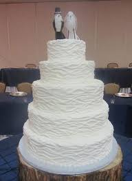 tier round white ruffled wedding cake with bird bride and groom