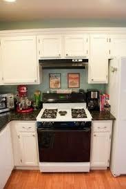 transform kitchen cabinets with krylon spray paint crafts