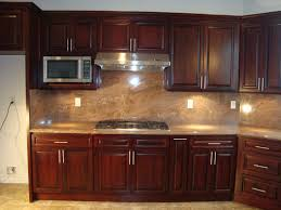 light brown marble back splash combined with brown wooden cabinet
