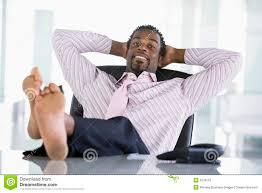 sur le bureau businessman sitting in office with on desk stock photo image