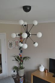 diy sputnik chandelier diy spray paint a striking sputnik pendant light
