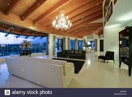 chandelier on curved wooden beamed ceiling in spanish living room