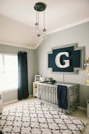 Modern Shag Rug Baby Boy Nursery Decorated With Large Wall Alphabet And Modern