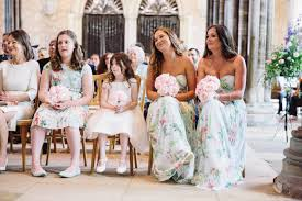 classic english garden wedding featuring floral bridesmaids dresses