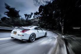 white nissan 350z nissan 350z nissan spoiler tuning white car white car speed speed