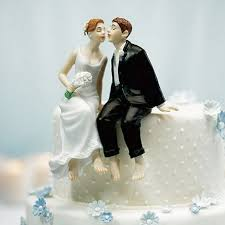 and groom wedding cake toppers whimsical sitting groom wedding cake topper