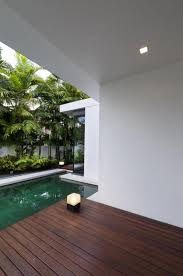 Tropical Laminate Flooring Nice Wooden Deck With Small Floor Lamp Aside The Pool In A