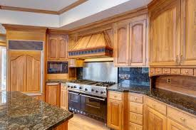 paint vs stain kitchen cabinets painted vs stained cabinets