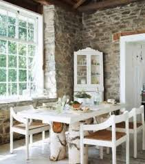 rustic style interior dining room with white table and chairs and