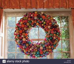 large christmas wreath made of multi coloured baubles hanging in