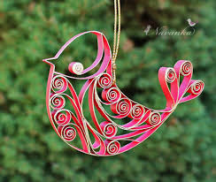 paper quilling and gold bird ornament in gift box bird