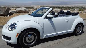 green volkswagen beetle convertible it u0027s summertime and volkswagen and buick have convertibles puget