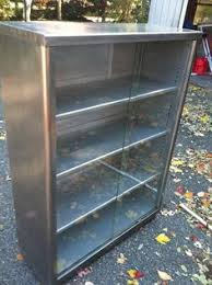 Metal Bookcase With Glass Doors Industrial Metal Cabinet W Sliding Glass Doors I Want These