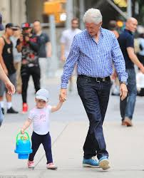 bill clinton walks dogs around madison square park while hillary