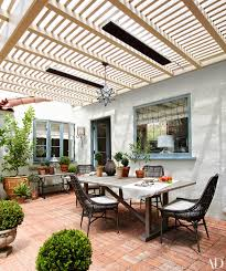 the terrace now serves as an alfresco dining room featuring a