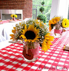 table centerpieces with sunflowers sunflowers and baby s breath in mason jars for an i do bbq floral