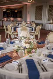 rose gold and navy wedding reception decor with low blush rose