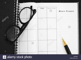 blank planning notebook and pen on desk use us organizer schedule