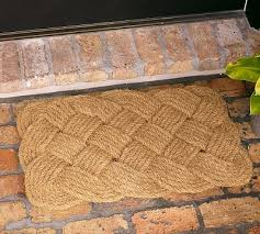unique coir knot door mat from pottery barn greet guests with a