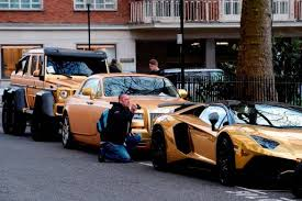 gold plated lamborghini aventador gold plated mercedes bentley and lamboughini owner picks up