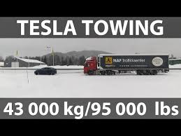watch a tesla model x pull a 95 000 lb semi truck in the snow