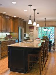 picturesque black kitchen island with brown cabinets interesting