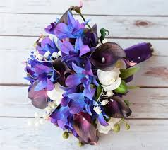 blue lilies tpurple blue mokara orchids and plum calla lilies touch