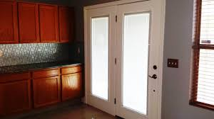 classic white wooden french door with frosted glass panel most