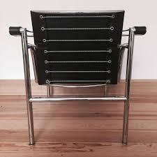 a pair of lc1 armchairs by le corbusier pierre jeanneret et