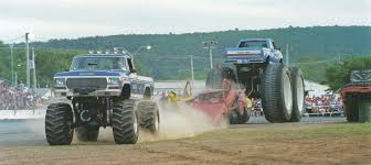bigfoot monster truck game bigfoot i and bigfoot v rip a car in half during a game of tug of