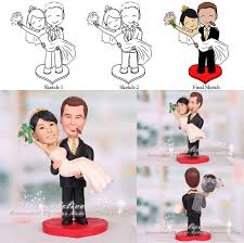 wedding toppers and groom groom picking up wedding cake toppers with cigar on