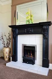 interior white fireplace with soft grey tile surround and white
