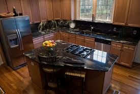 Espresso Cherry Cabinets With Golden Crystal Granite The Pairing - Black granite with white cabinets in bathroom