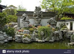 stylized chinese rock garden formation embedded with flowering