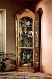 lighted curio cabinet oak lighted corner curio cabinet oak mahogany southern enterprises
