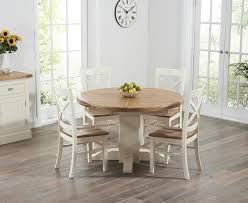 Buy The Torino Oak  Cream Extending Pedestal Dining Table With - Cream kitchen table