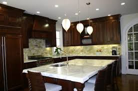 countertops dark wooden cabinet with white marble countertop