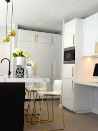White Kitchen Cabinets With Black Island by Black U0026 White Kitchen With Brass And Gold Accessories High Gloss
