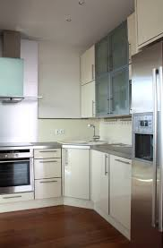 Kitchen Cabinets Layout Ideas by White Corner Styled Cabinet And Rosewood Floor For Stylish Small