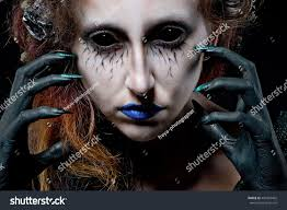 mermaid woman monster creative dark makeup stock photo 487369402