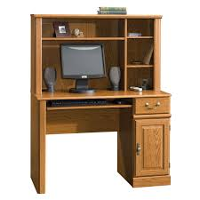 light brown wooden desk with long shelf above the top and smaller