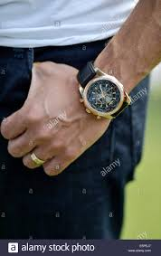 bentley breitling clock a man u0027s hand with a breitling watch and a wedding ring stock photo