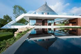 ultra modern exterior house design with large glass window and