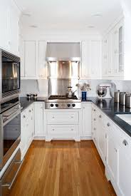 small kitchen design white u shaped kitchen black countertops wood