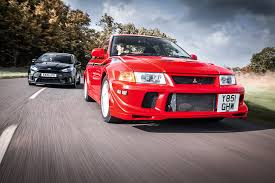 mitsubishi evo red and black icon buyer new ford focus rs vs used mitsubishi evo vi by car