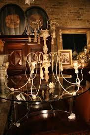 Italian Wood Chandelier Vintage Italian Wood Chandelier With Gilt Tassles Sold