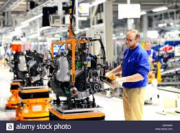 volkswagen mexico plant production of vw cars in a factory worker at gearbox unit stock