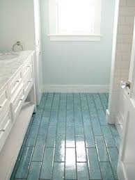 love the colored floor tiles and coordinating wall color idea