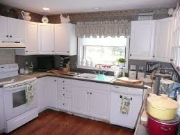 painted laminate kitchen cabinets how to paint laminate kitchen cabinets without sanding laminate