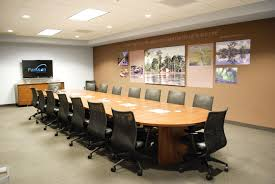 meeting room ideas with oval solid wood conference table and gray